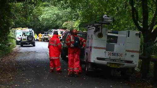Rescue crews trekked to the lightning strike scene. (9NEWS)