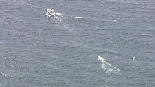 The boat was faced with challenging swells of up to two metres when it capsized. Picture: 9NEWS.