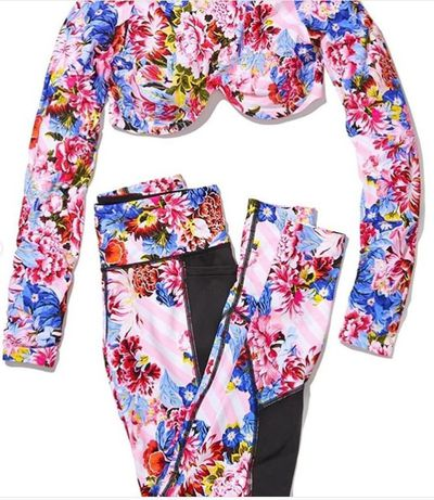A purple and pink floral active wear set from the new&nbsp;<em>VS Loves Mary Katrantzou</em>&nbsp;collection.