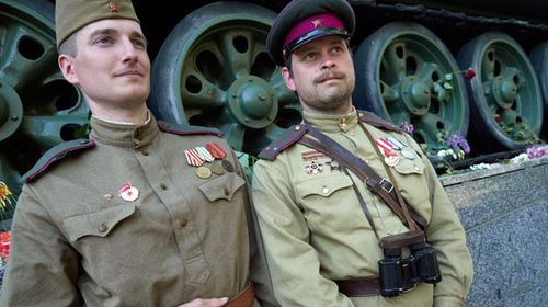 Russians in World War II uniforms celebrate the defeat of Nazi Germany 73 years ago. (AP).