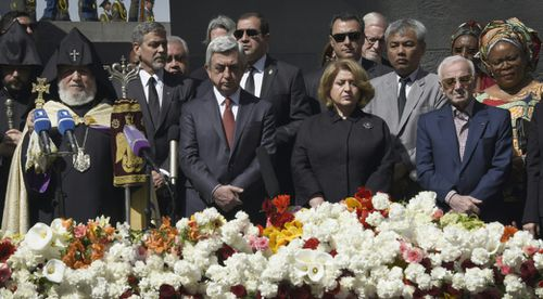 George Clooney, Armenian President Serzh Sarkisian, his wife Rita Sarkisian and French and Armenian singer Charles Aznavour at the ceremony. (AFP)