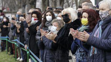 With heavy hearts, Italians mark pandemic milestone