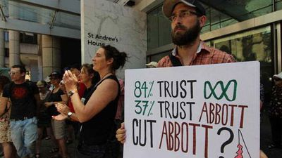 More than 400 staff are expected to lose their jobs as the ABC loses 10 percent of its operating budget. Click through to see where the cuts will take place. Here, protesters rally outside Sydney Town Hall in reaction to the budget cuts. (AAP)