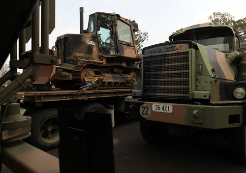 An Australian Defence Force MACK Truck and bulldozer to be used by Australian Army Reserve and Regular personnel