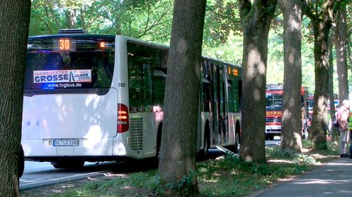 A bus stands on a street in Luebeck, northern Germany, after a man attacked people inside. (AAP)