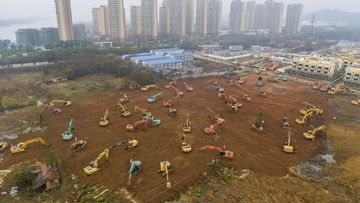 Heavy equipment works at a construction site for a field hospital in Wuhan in central China's Hubei Province.