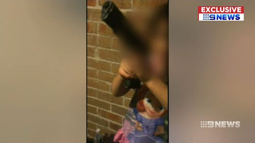 A Sydney father is behind bars for letting his daughter play with his gun.