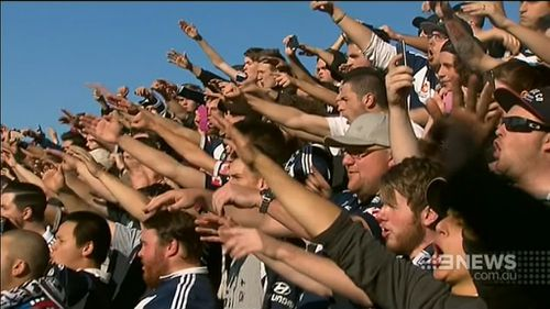 A number of football fans set off flares on the way to the ground. (9NEWS)