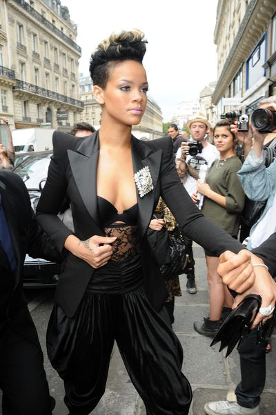 Rihanna accessorised her mullet-style haircut and purple lip with a jacket, bustier and pants by Balmain outside the French fashion house's S/S '10 show in Paris, September 2009