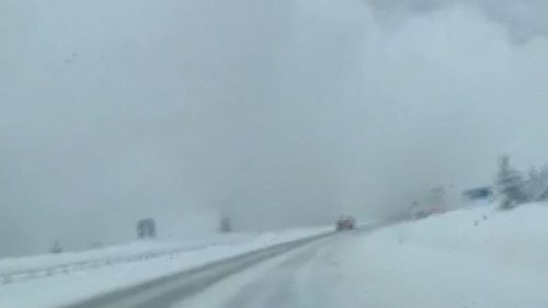 Video captured the moment a car was hit by an avalanche.
