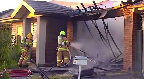 Emergency services rushed to control the fire, which gutted the home's garage and caused significant damage to the structure.