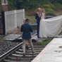 Railway operator blasts couple taking wedding photos on railroad tracks