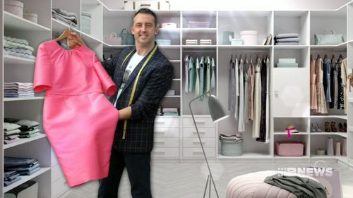Moore with Ms Palaszczuk's pink dress for the opening ceremony. (9NEWS)