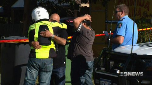 Family members are comforted by one another. Picture: 9NEWS