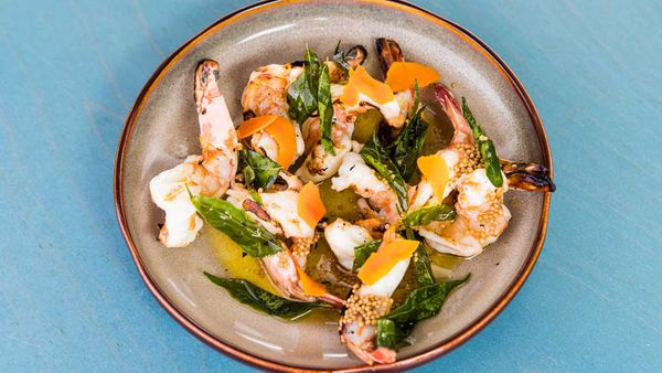 Chargrilled prawns with pickled tumeric, brown butter and crispy curry leaves