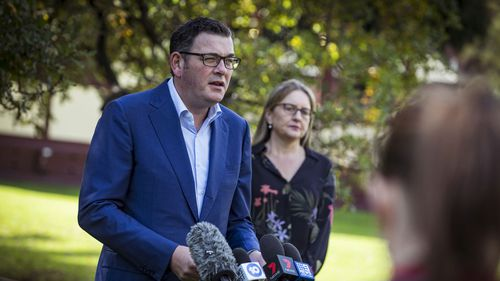 Premier Daniel Andrews speaking to reporters in a park in Melbourne.