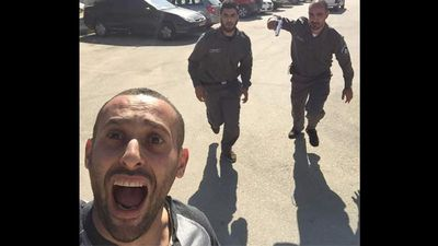 Palestinian rapper Tamer Nafar poses for a selfie as he flees police.