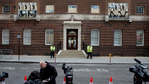 Guards outside the Lindo Wing at St. Mary's Hospital in London shortly after Duchess Kate arrived. (AAP)