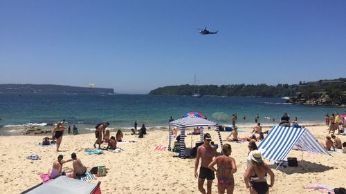 Three people have been rescued after a boat capsized in Balmoral Bay.
