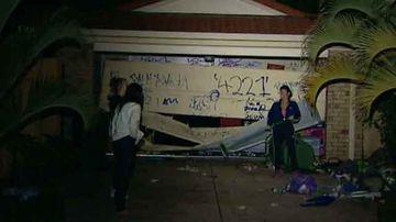 Damaged garage door at the Gold Coast property.