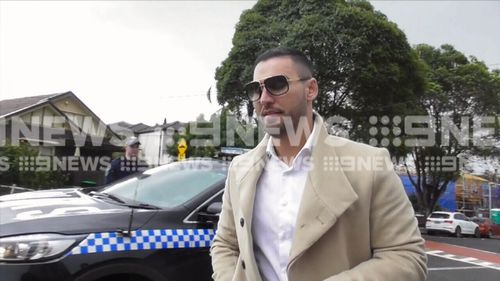 Salim Mehajer arrives at his Lidcombe property during the raid. Picture: 9NEWS