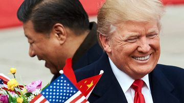 China's President Xi Jinping and US President Donald Trump during a meeting outside the Great Hall of the People in Beijing.