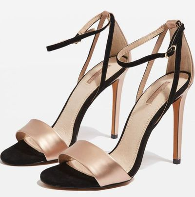 "Super sexy stiletto heels add elegance to everything. <a href=""https://au.topshop.com/raphael-black-sandals.html"" target=""_blank"">Topshop Raphael Black Sandals, $89.95.</a>"