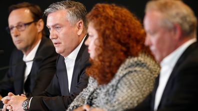 Eddie McGuire addresses the media alongside other Collingwood leaders.