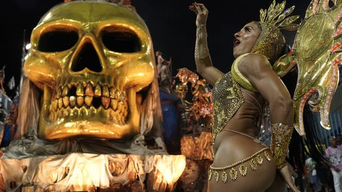 A performer from the Estacio de Sa samba school parades during Carnival celebrations at the Sambadrome in Rio de Janeiro in February this year.