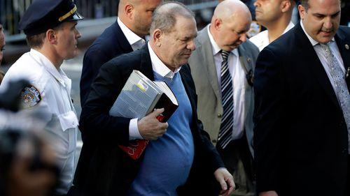 Harvey Weinstein arrives at the New York police precinct. (AAP)