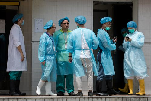 Staff at slaughterhouses in Hong Kong are forced to wear protective gear as they do mass culls of stock to prevent the swine flu from spreading further.