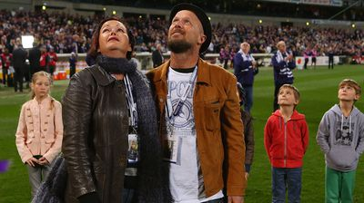 Rin Norris and Anthony Maslin parents of MH17 crash victims Evie, Mo and Otis Maslin look on after releasing balloons. (Getty)