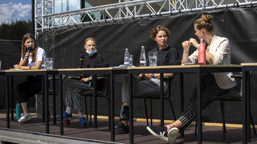 German climate activist Luisa Neubauer (L-R), Swedish climate activist Greta Thunberg, Belgian climate activist Anuna De Wever and Belgian climate activist Adelaide Charlier attend a press conference following the meeting with German Chancellor Angela Merkel on August 20, 2020 in Berlin, Germany