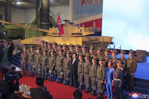 """Kim Jong Un reviewed the rare exhibition and vowed to build an """"invincible"""" military, as he accused the United States of creating regional tensions."""