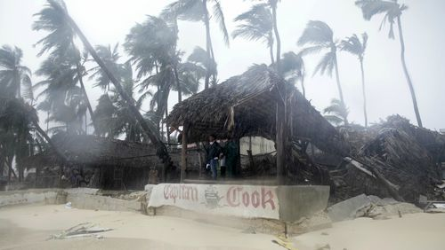 A person looks out from the Captain Cook restaurant damaged during the crossing of Hurricane Maria, on Cofrecito Beach, in Bavaro, Dominican Republic.