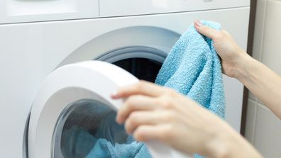 Person loading laundry