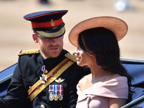 Meghan stunned in an off-the-shoulder pink dress.