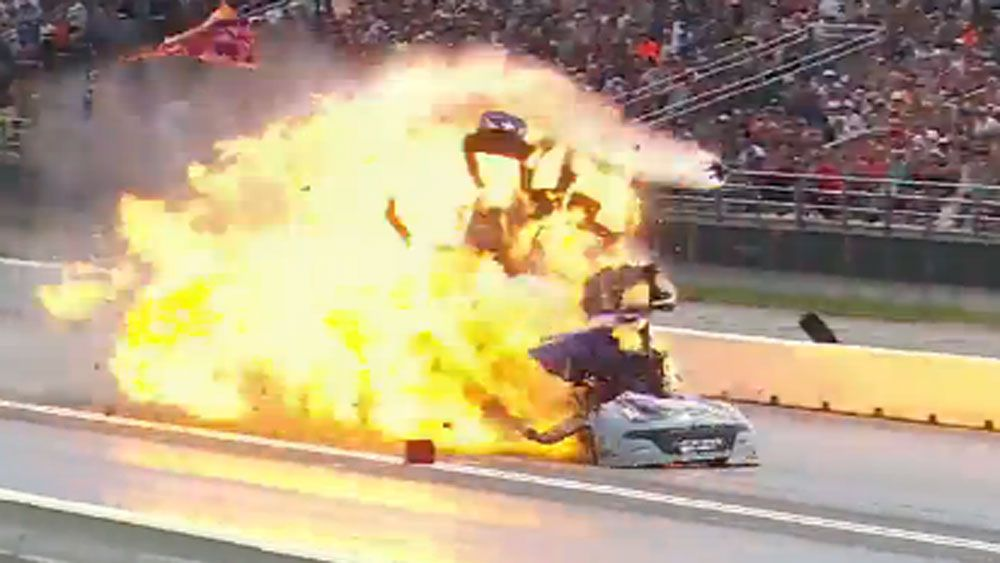 Drag racer keeps his cool as car explodes