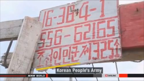 "One of the ships bore a sign in Korean that reads ""Korean People's Army"". (NHK)"