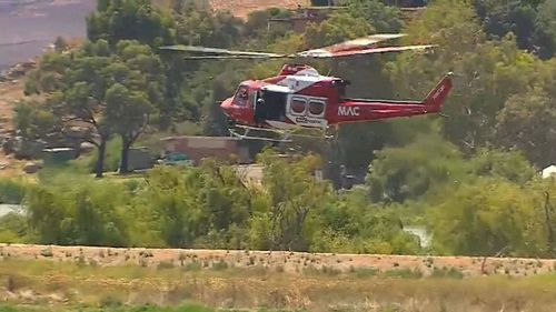 A police helicopter attempts to 'flush out' Kirchner. (9NEWS)