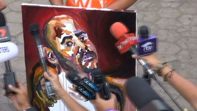 Chinthu Sukumaran holds one of his brother's final works. (9NEWS)