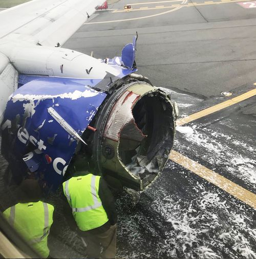 The mangled engine of the plane on the tarmac at Philadelphia. Picture: AP