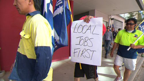 The workers claim they're owed $5 million. (9NEWS)