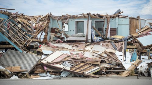 Louisiana residents still reeling from flooding and damage caused by Hurricane Ida scrambled for food, gas, water and relief from the sweltering heat.