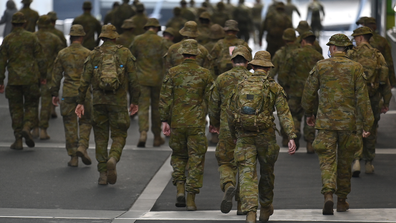 Members of the Australian Defence Force walk through the city on July 27, 2020 in Melbourne, Australia. Victoria has recorded 532 new cases of coronavirus and six more deaths.