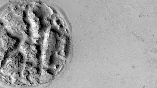 Scientists scratching heads over 'cookie' landform on Mars
