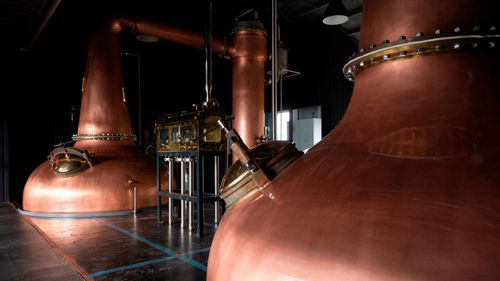 """Gin is distilled in copper stills. The stills used by Kiuchi Brewery have a """"swan neck"""" design."""