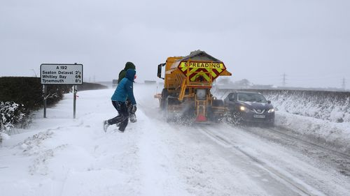 People throw snowballs at vehicles travelling on the A192 near Seaton Delaval. (AAP)