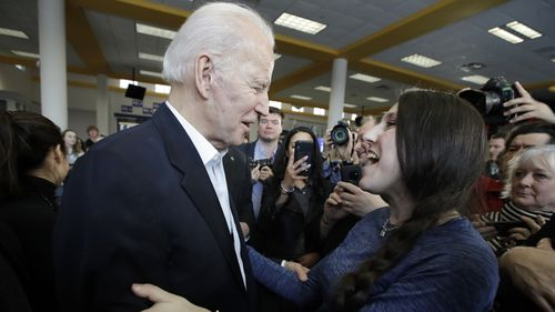 Former Vice President Joe Biden meets a supporter in Iowa.