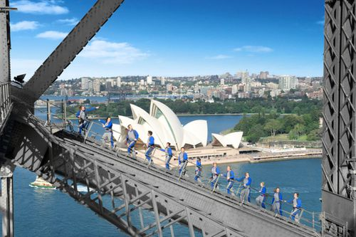 Four million people from 140 countries have donned blue jumpsuits with BridgeClimb in 20 years. Picture: BridgeClimb